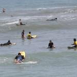 Surfers in Lima, Peru